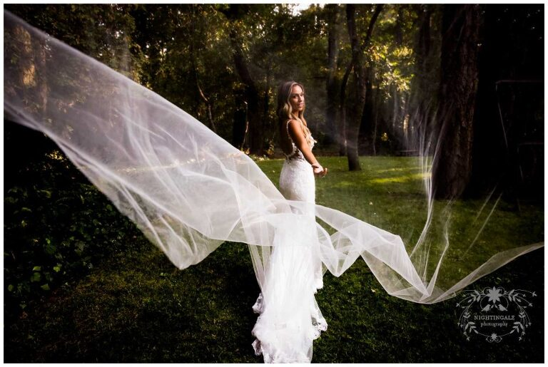 Bride with long veil at her Napa Valley wedding