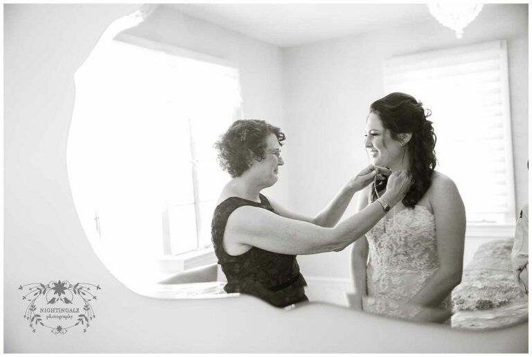 bride's mother helps her get ready for her napa wedding