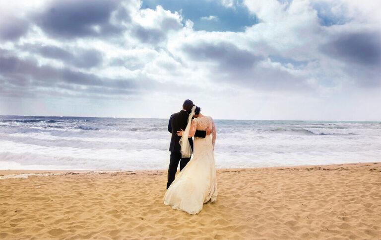 Bride and groom on beach at their Ritz-Carlton Half Moon Bay wedding