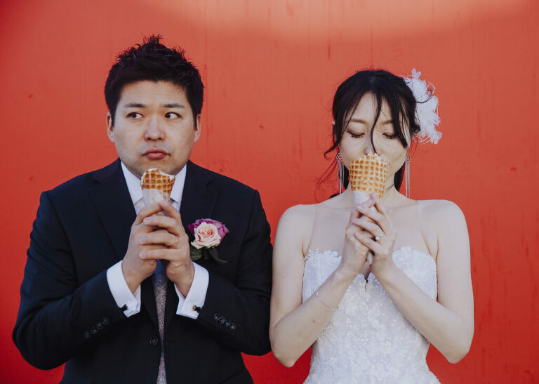 Modern wedding couple eat ice cream in San Francisco