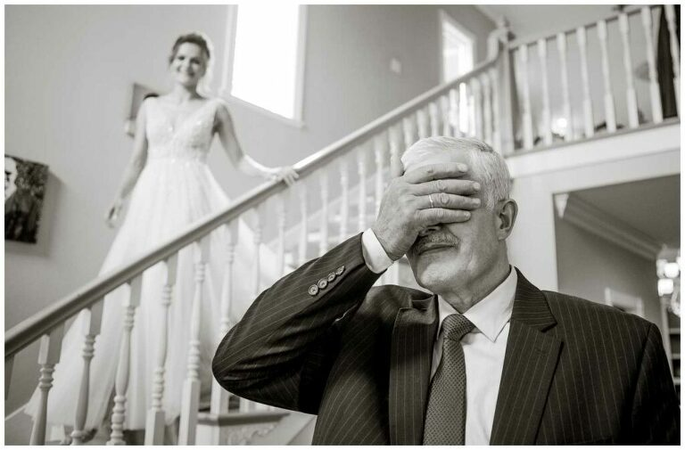 father gets ready to see his daughter in her wedding gown