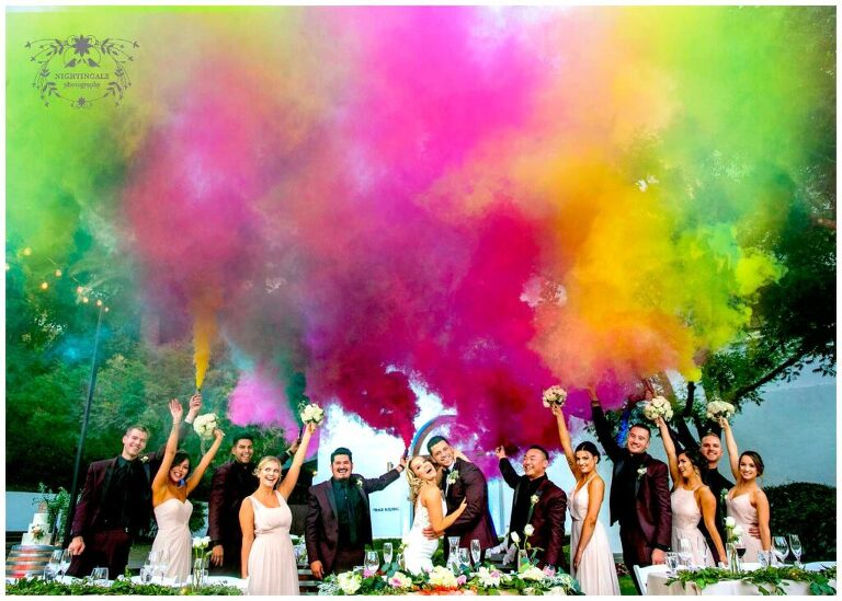 colorful smoke bombs with bridal party at wente vineyards
