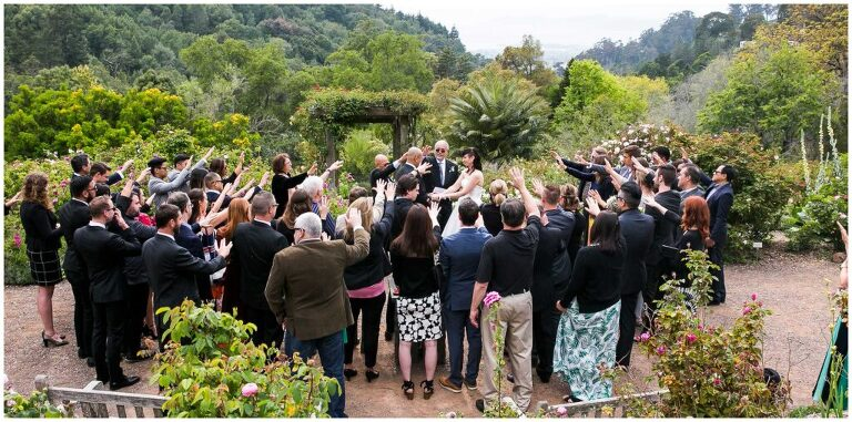 a crowd gathers around a small wedding at the UC botanical gardens
