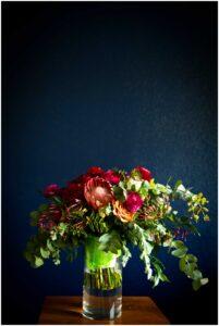 lush bouquet against blue wall