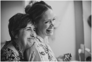 a bride gets a kiss from her mother before her wedding