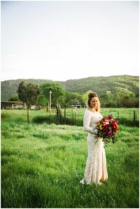 gorgeous bride has portraits in her rustic backyard