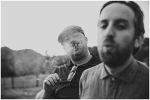 guests smoke cigars at a casual california wedding