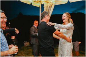 couple dances at their backyard wedding reception